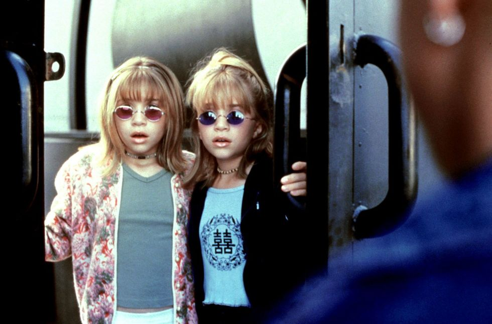 Mary-Kate and Ashley Olsen wearing colour-tinted sunglasses